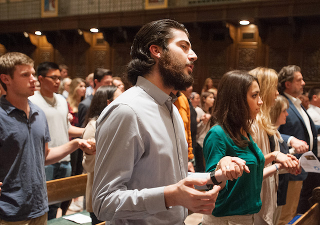 Students at mass in Founders Chapel