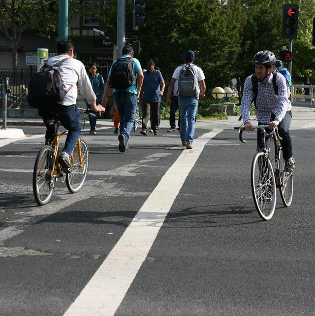 people riding bicycles