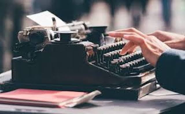 typewriter with fingers typing