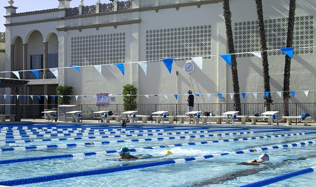 Photo of swimmers and staff in and around the Sports Center pool