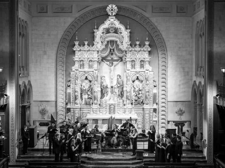 Choral scholars playing music at church altar