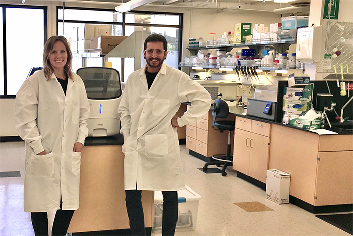 CEO Natalie Castellana and co-worker in lab