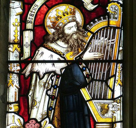 lead glass window of man playing harp