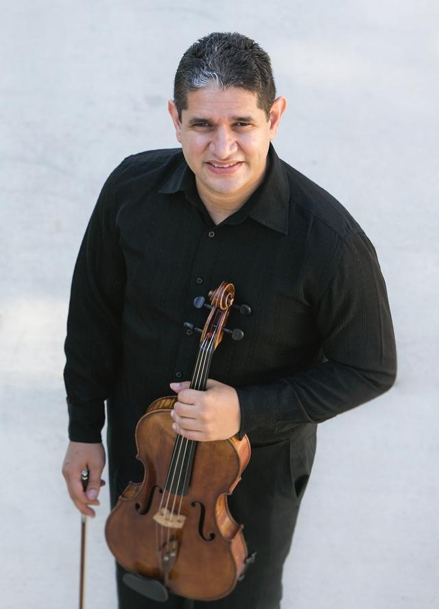 Portrait of Ramon Negron holding violin