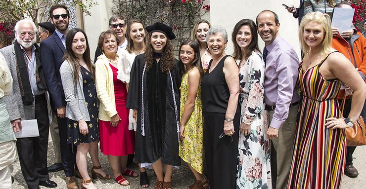 Juliana Mascari, middle, celebrated with her family members at the May 18 USD School of Law graduation. Mascari is a double alumna of USD, having received her BA in English in 2016.