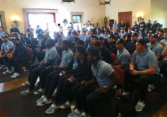 USD football players watch in anticipation of learning who they'll play in the first round of the FCS Playoffs.