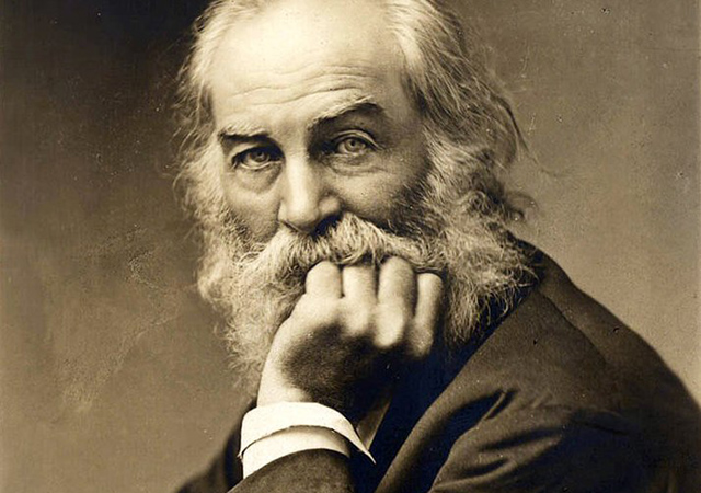Close up of Walt Whitman resting his chin in his hand.