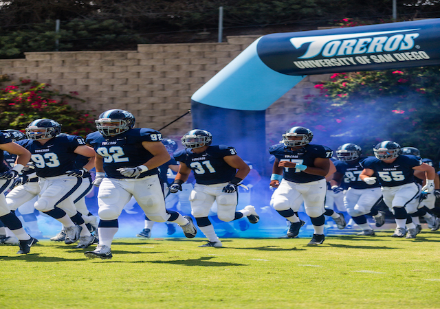 USD Football team running onto the field at Torero Stadium