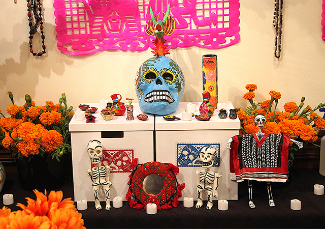A close-up view of one level of the altar that is on display in the Hahn University Center Exhibit Hall (across from Torero Store) this week in recognition of Dia de los Muertos.