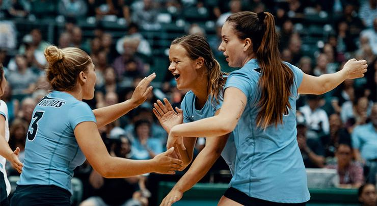 USD volleyball's Megan Jacobsen celebrates a point with teammates. The Toreros won two of three matches in Santa Barbara last weekend.