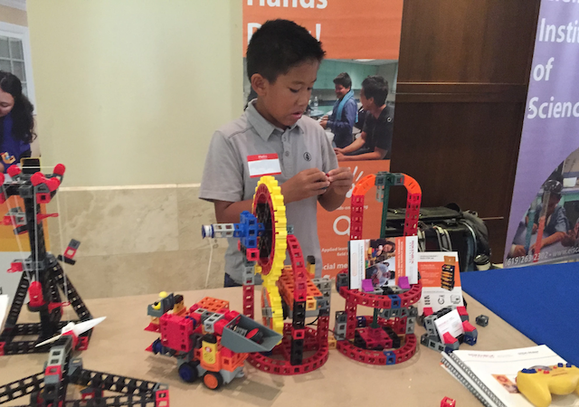 A student building at a USD STEAM Academy event