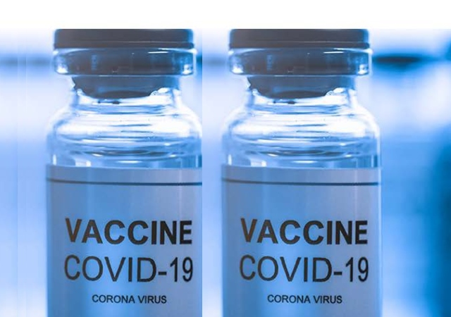 two vaccine vials in light blue that say Covid-19 Vaccine