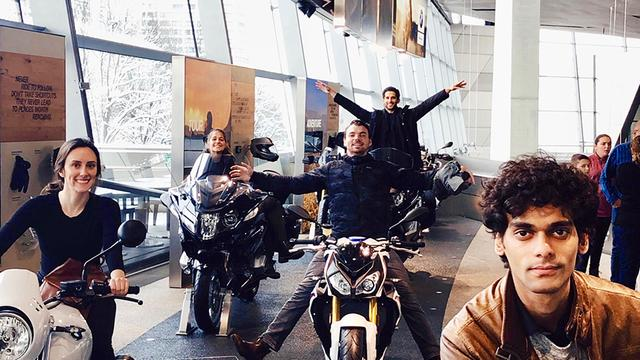 USD MBA students pose on motorcycles at BMW Motorrad