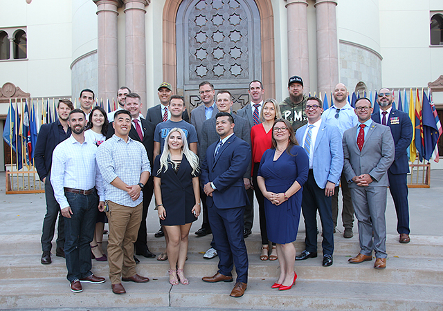 Student, staff and alumni veterans present for USD's Veterans Day celebration on Nov. 8 pose for a group photo.