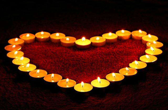 lit candles in a heart shape