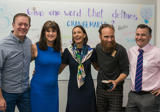 Kroc School Professors Karen Henken, second from left, and Austin Choi-Fitzpatrick, second from right, are teaching in the social innovation master's program.