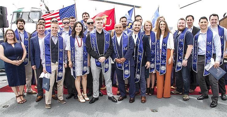 Members of USD's Military and Veteran Program celebrate at their recognition ceremony in May. On Aug. 4, STEP and USO San Diego host Cammies to College event at the Liberty Station Conference Center.