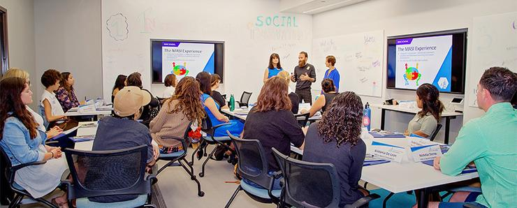 Students listen during a Master of Arts in Social Innovation class with Kroc School professors Karen Henken, Austin Choi-Fitzpatrick and Necla Tschirgi.