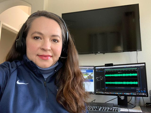 Photo of Claudia Gonzales in home office recording podcast