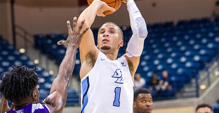 Tyler Williams takes a shot during a men's basketball game. Williams played well in USD's two games this past week against Washington and San Diego Christian.