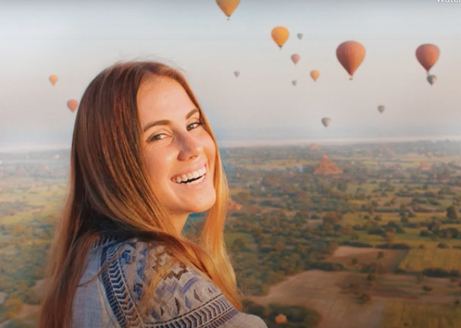 An international business senior at the USD School of Business at an open field overlooking hot air balloons
