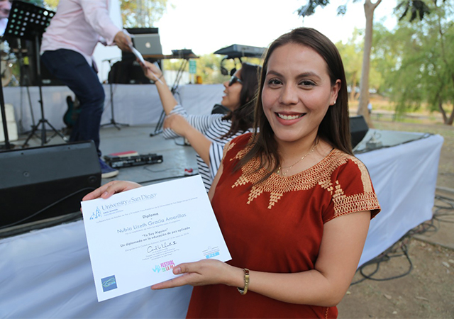 A student receiving her diploma