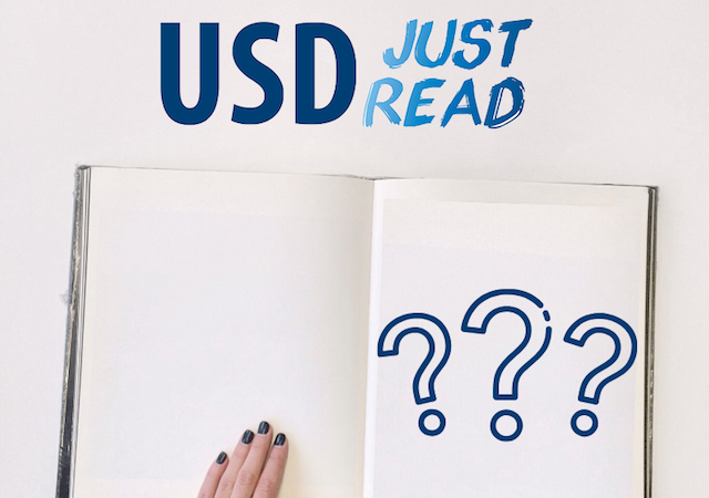"Image of open book that has 3 large questions marks. Above reads ""USD Just Read!"""