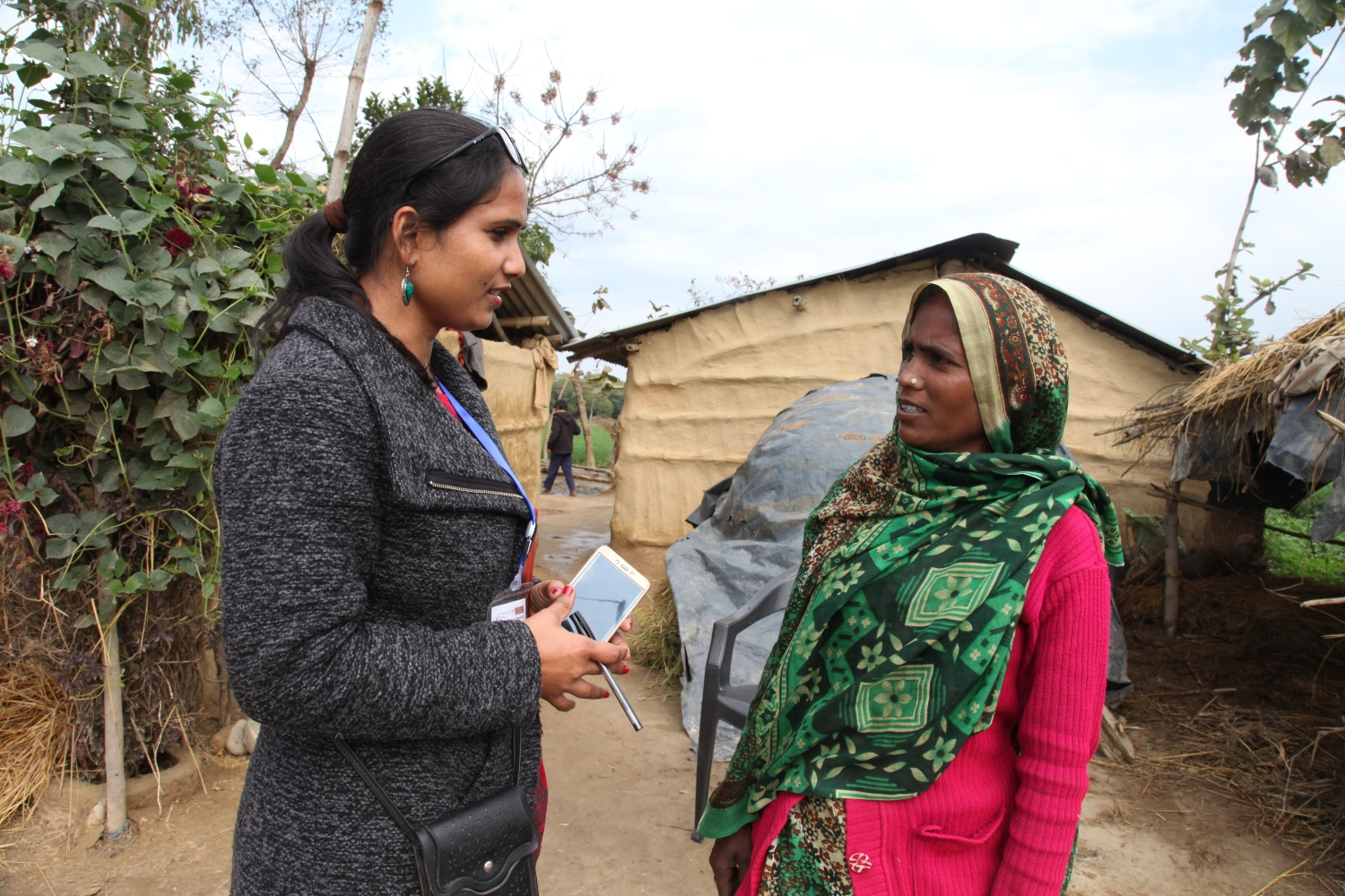 Woman interviewing another woman in Nepal