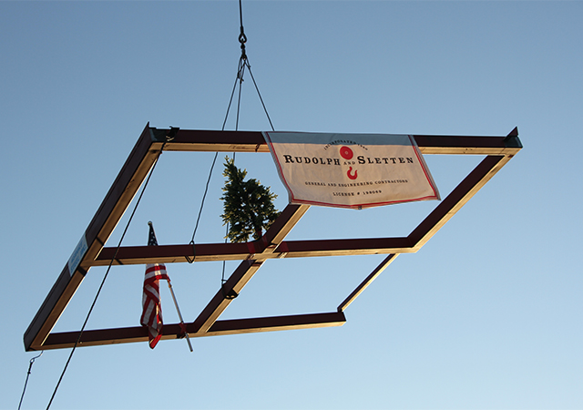 A top beam for the Learning Commons building goes up in the air after USD campus community members had the chance to sign a message. The Learning Commons is expected to open in Fall 2020.