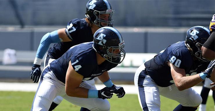 USD football players Jacob Bergstrom (14), Kim Mahoney (37) and Jake Wittwer (90) are poised to go after the opponent. USD won Saturday at Drake, 27-10.