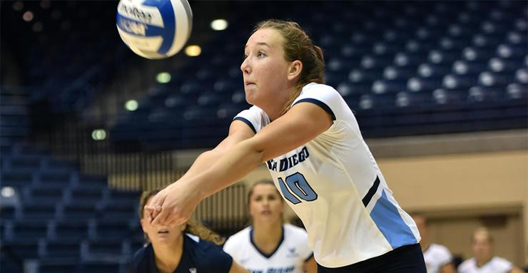 Cami May digs a volleyball out for the USD women's team. The Toreros split their first two West Coast Conference matches last week at home.