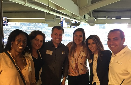 Law Firm Challenge captains celebrating at a San Diego Padres game