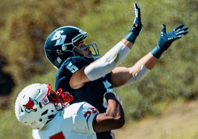 Toreros wide receiver Michael Bandy reaches for a pass in a recent USD football game.