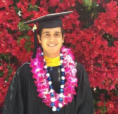 Nima in graduation robes