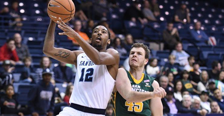 USD's Juwan Gray goes up for a shot, getting around a University of San Francisco defender in USD's WCC-opening win on Dec. 28 in the Jenny Craig Pavilion.