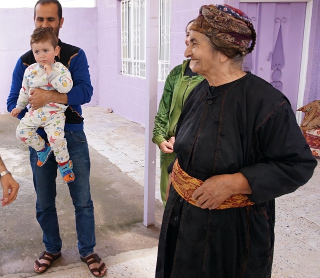 A former IDP family in front of their newly rebuilt house in Tel Isqof, a town just north of Batnaya that escaped major damage