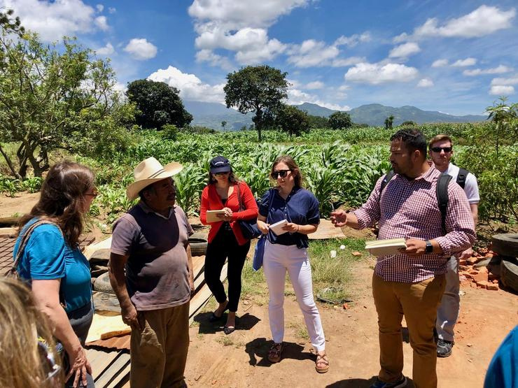 USD students talk to a farmer in Antigua, Guatemala
