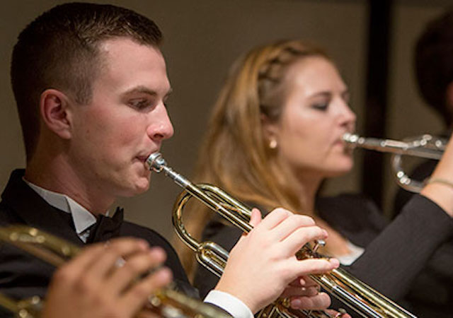 student playing trumpet at concert