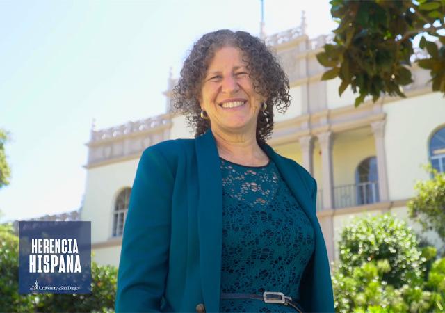 Image of Perla Myers, PhD, in front of Saints Tekakwitha & Serra Ha