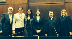 USD law students Erin Casey and Catherine Huang with coach and judges