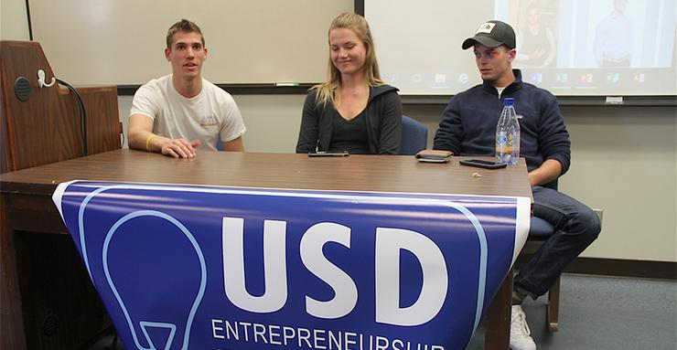 Warren Lorenz, far left, makes a point during a USD Entrepreneurship Club event. Lorenz, Irina Gedarevich and Robert Walker, all current students and Greek Life members, talked about their businesses.