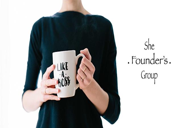 closeup of a woman holding a coffee mug