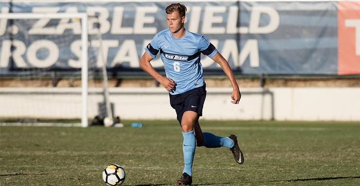 University of San Diego men's soccer defender Aaron Frey moves the ball. Frey was one of the standouts for the Toreros in a scoreless draw last Friday.