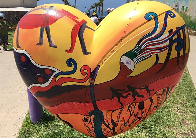 Heart mural art display while at Playas de Tijuana