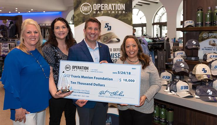 University of San Diego, winners of the national 2018 Operation Hat Trick Service Award, donated the $10,000 prize to the Travis Manion Foundation. TMF's Derek Abbey accepted the check from USD.