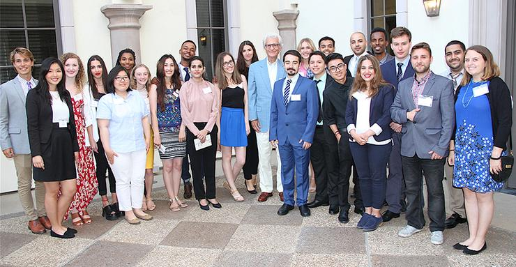 The 2017 Hansen Summer Institute on Leadership and International Cooperation surround Tony Dimitroff, director of the Fred J. Hansen Foundation. The institute program runs at USD through July 23.