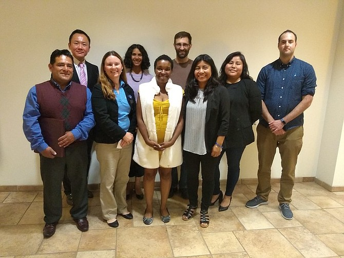 Aarti Ivanic, MBA academic director at USD School of Business, stands alongside MBA students, micro-entrepreneurs, Access Inc. partners,and USD faculty and staff