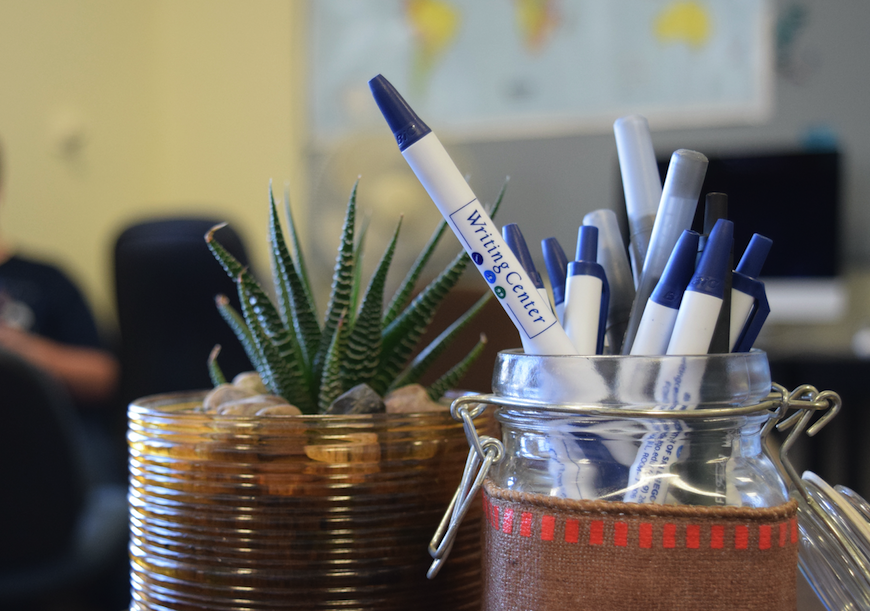 Writing Center pens and plant