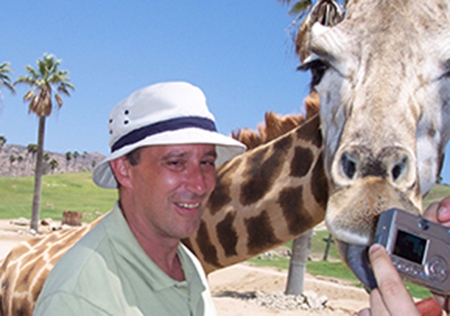 joseph colombo at the zoo with giraffe