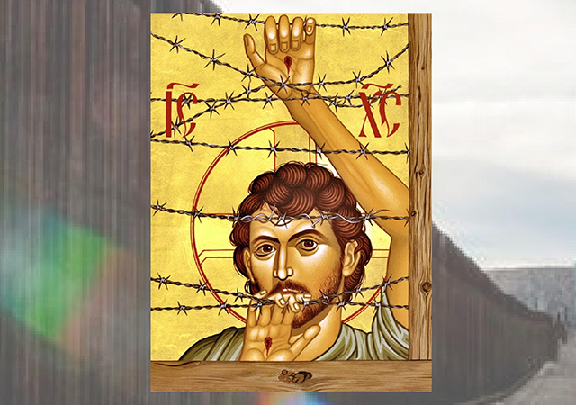 Image of an religious icon in front of a border wall